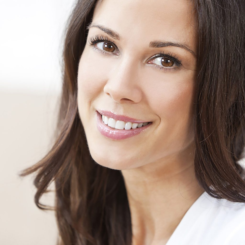 Brunette Woman with Long Hair Smiling